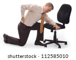 Image of business man hunched over holding his pack in pain. - stock photo