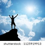 man on top of mountain.... | Shutterstock . vector #1125919913