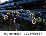 oil drill pipe. rusty drill... | Shutterstock . vector #1125950657