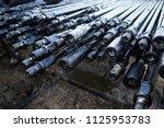 oil drill pipe. rusty drill... | Shutterstock . vector #1125953783