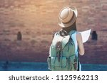 tourist travel woman looking at ... | Shutterstock . vector #1125962213