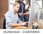 male designer working at modern ... | Shutterstock . vector #1126018463