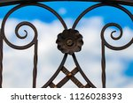 wrought iron gates  ornamental... | Shutterstock . vector #1126028393