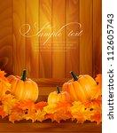 Pumpkins On Wooden Background...