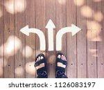 selfie feet on wooden...   Shutterstock . vector #1126083197