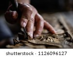 hands of craftsman carve with a ... | Shutterstock . vector #1126096127