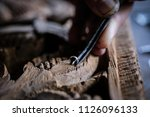 hands of craftsman carve with a ... | Shutterstock . vector #1126096133
