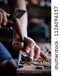hands of craftsman carve with a ... | Shutterstock . vector #1126096157