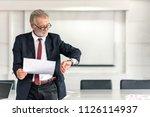 mature ceo businessman checking ...   Shutterstock . vector #1126114937
