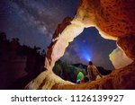 a man stargazing under an arch... | Shutterstock . vector #1126139927