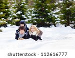 Happy Family Lying On The Snow...