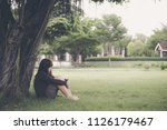 asian woman sitting alone and... | Shutterstock . vector #1126179467