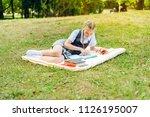 student in uniform with... | Shutterstock . vector #1126195007