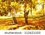 Children Playing With Autumn...