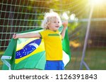 kids play football on outdoor... | Shutterstock . vector #1126391843