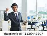 happy young indian businessman... | Shutterstock . vector #1126441307