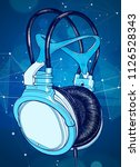 bright colored headphones on a... | Shutterstock .eps vector #1126528343