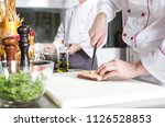 chef cutting meat on chopping... | Shutterstock . vector #1126528853