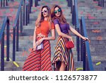 outdoor. two girl on stone... | Shutterstock . vector #1126573877