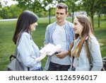 group of students at the park. | Shutterstock . vector #1126596017