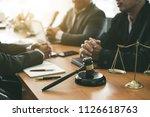 business lawyer team. working... | Shutterstock . vector #1126618763