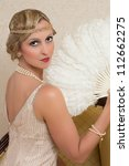 Vintage twenties lady wearing a headband and flapper dress - stock photo
