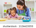 happy mother and daughter are... | Shutterstock . vector #1126623353
