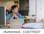 focused young asian designer... | Shutterstock . vector #1126770227