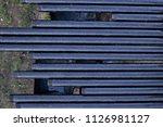 oil drill pipe. rusty drill... | Shutterstock . vector #1126981127