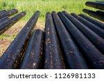 oil drill pipe. rusty drill... | Shutterstock . vector #1126981133