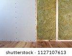 wooden frame for future walls... | Shutterstock . vector #1127107613