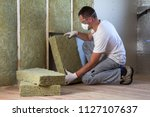 worker in protective goggles... | Shutterstock . vector #1127107637