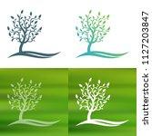 abstract tree concept logo.   Shutterstock .eps vector #1127203847