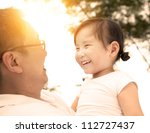 happy little girl with father | Shutterstock . vector #112727437