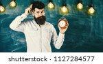 teacher in eyeglasses holds... | Shutterstock . vector #1127284577