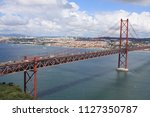 the 25 de abril bridge   tagus... | Shutterstock . vector #1127350787
