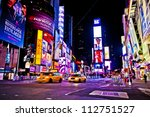 Stock photo new york city dec times square is a busy tourist intersection of neon art and commerce and 112751527