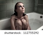 beautiful young woman in bath - stock photo
