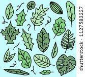 hand drawn set of leaf doodles. ... | Shutterstock .eps vector #1127583227