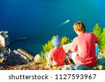 father and little son travel in ... | Shutterstock . vector #1127593967