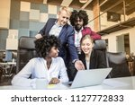 colleagues brainstorming in the ... | Shutterstock . vector #1127772833