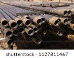 oil drill pipe. rusty drill... | Shutterstock . vector #1127811467