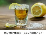 gold mexican tequila with salt  ... | Shutterstock . vector #1127886437