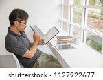 a young entrepreneur is...   Shutterstock . vector #1127922677
