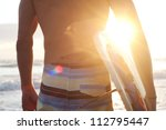 surfer on the beach holding... | Shutterstock . vector #112795447