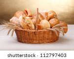 Various bakery products in basket - stock photo