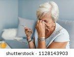 tired elderly person. senior... | Shutterstock . vector #1128143903