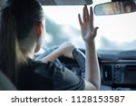 angry woman driver. rushing to... | Shutterstock . vector #1128153587