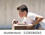 caucasian11 years old boy... | Shutterstock . vector #1128186263