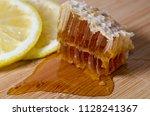 honeycomb full of honey with...   Shutterstock . vector #1128241367